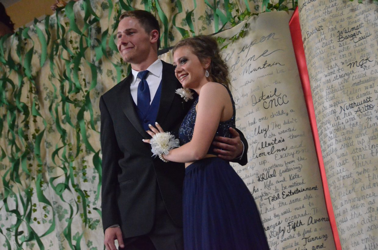 Miki Klimper, left, and Megan Olinger pose for the Grand March during Moffat County High School prom at Clarion Inn & Suites.