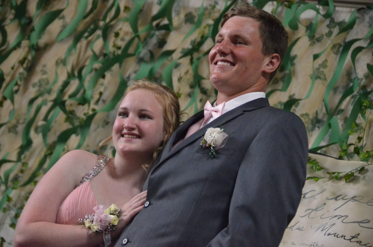 Kelsey Stauffer, left, and Toryn Hume pose for the Grand March during Moffat County High School prom at Clarion Inn & Suites.