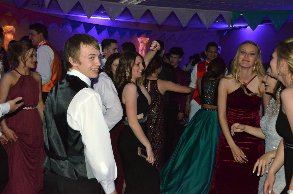 Students keep the energy going on the dance floor during Moffat County High School prom at Clarion Inn & Suites.