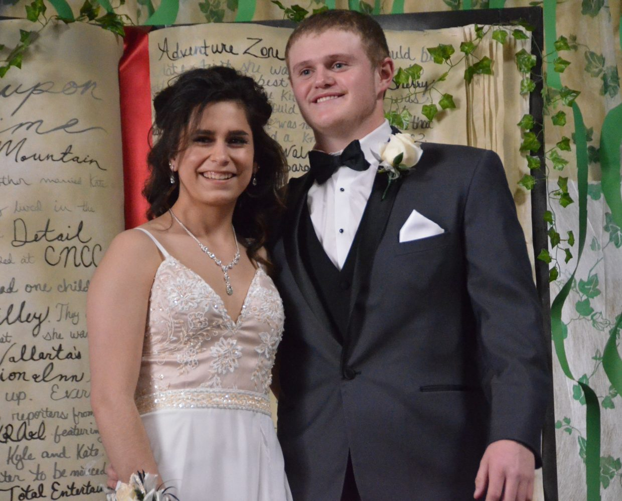 Thalia Carbajal, left, and Braeden Barnes pose for the Grand March during Moffat County High School prom at Clarion Inn & Suites.