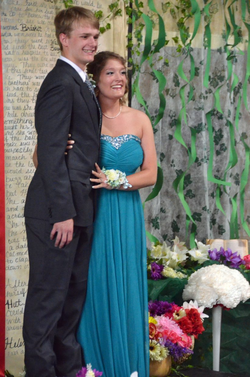 Jordan Vorland, left, and Morgan Nelson pose for the Grand March during Moffat County High School prom at Clarion Inn & Suites.