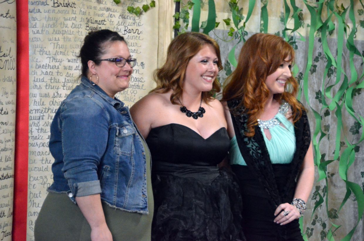 Brenna Knez, center, poses with organizers Jessica Baker and Shana Folley to start the Grand March during Moffat County High School prom at Clarion Inn & Suites.
