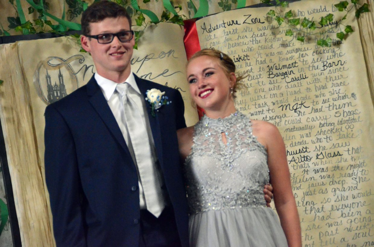 Colin Jensen, left, and Makenna Knez pose for the Grand March during Moffat County High School prom at Clarion Inn & Suites.