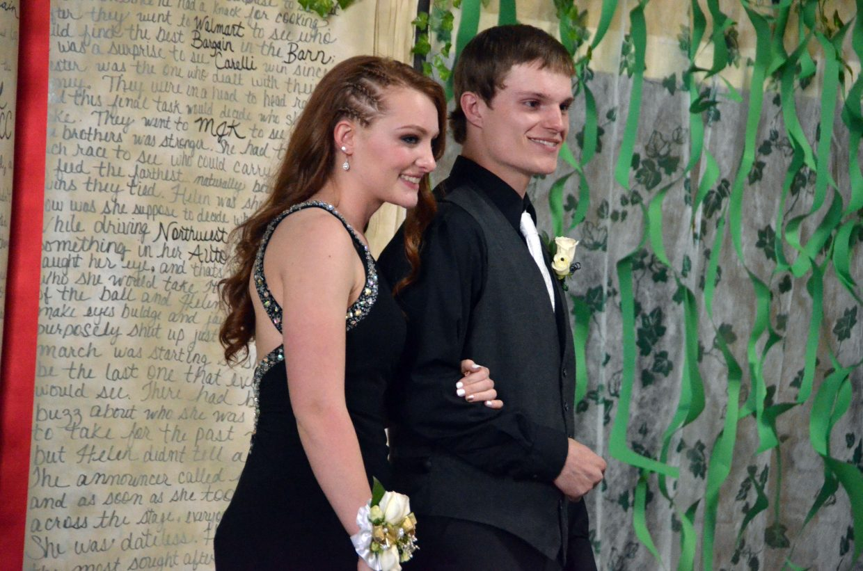 Rylie Anderson, left, and Drake Zimmerman pose for the Grand March during Moffat County High School prom at Clarion Inn & Suites.