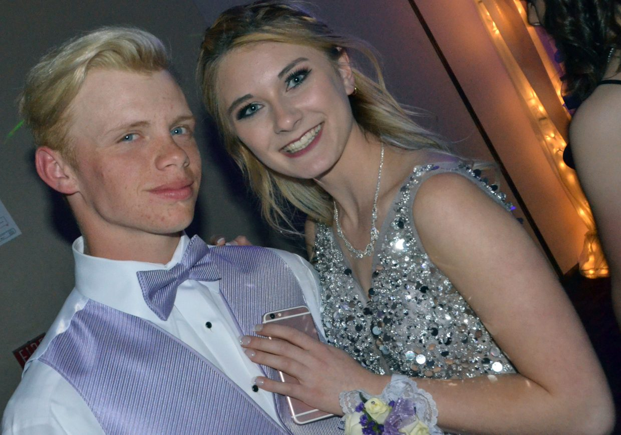 Adain Wilmot, left, and Emily Magruder enjoy the dance floor during Moffat County High School prom at Clarion Inn & Suites.