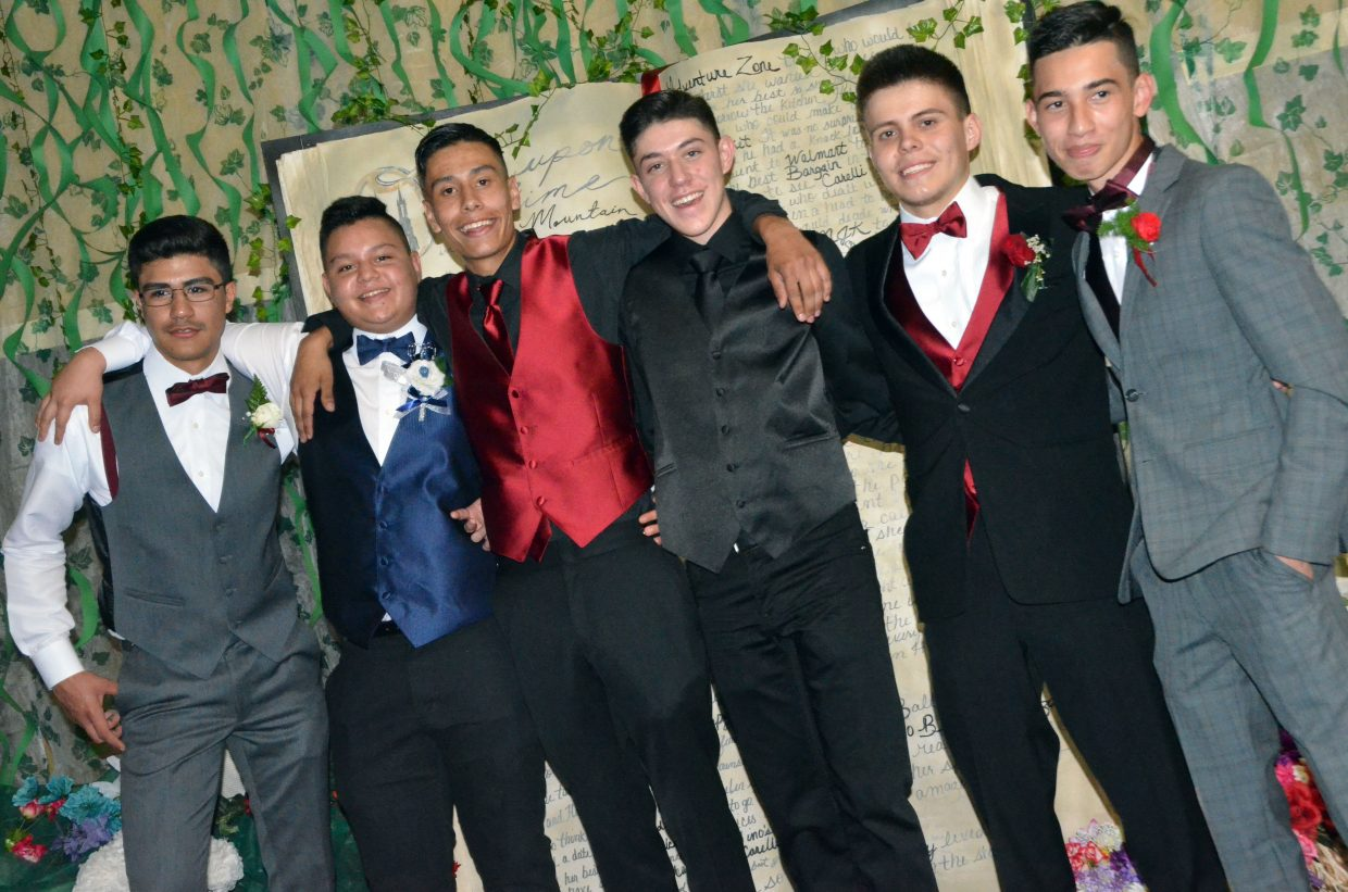 From left, Luis Salazar, Joahan Quezada, Axeel Mendoza, Brian Yanez, Hilario Mendoza and Ricky Castro pose onstage during Moffat County High School prom at Clarion Inn & Suites.