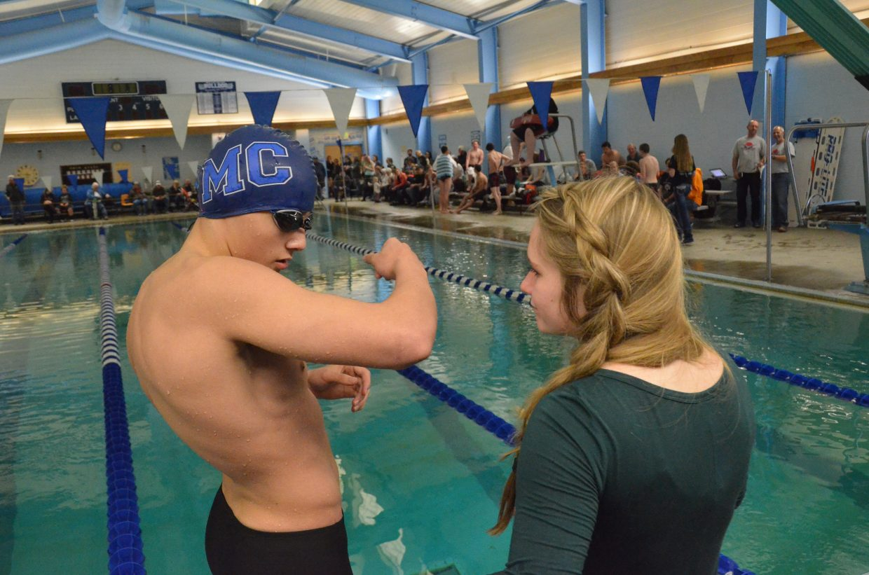 Moffat County High School's Ethan Powers and Molly Neton await the 100-meter backstroke during MCHS's Friday meet.
