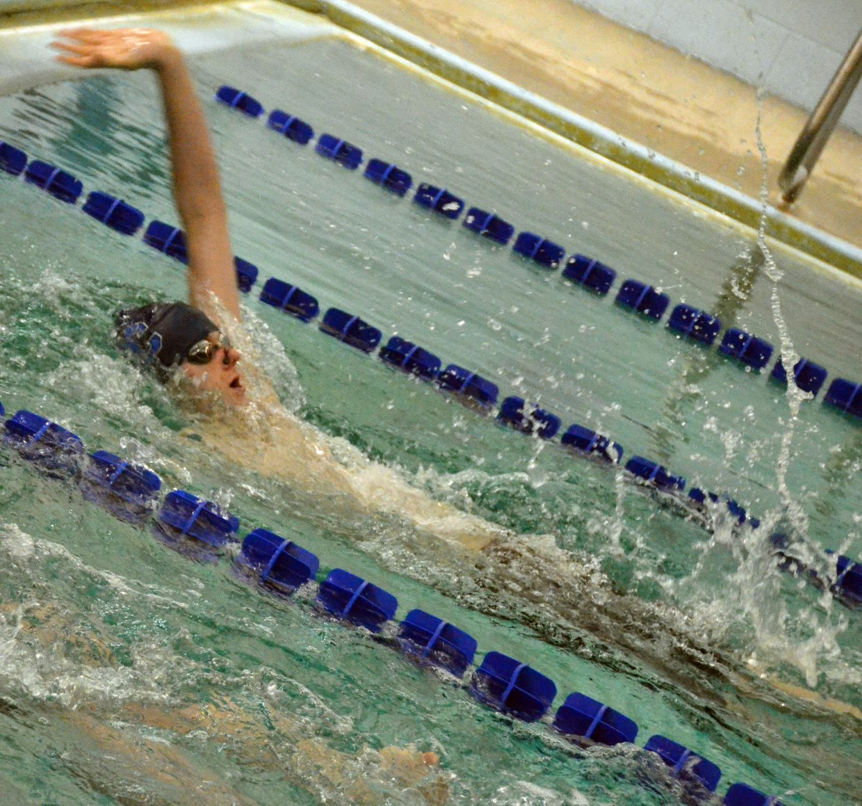 Moffat County High School swimmer Cody Evaristo has only a few feet to go in the 100-meter backstroke relay during MCHS's Friday meet.