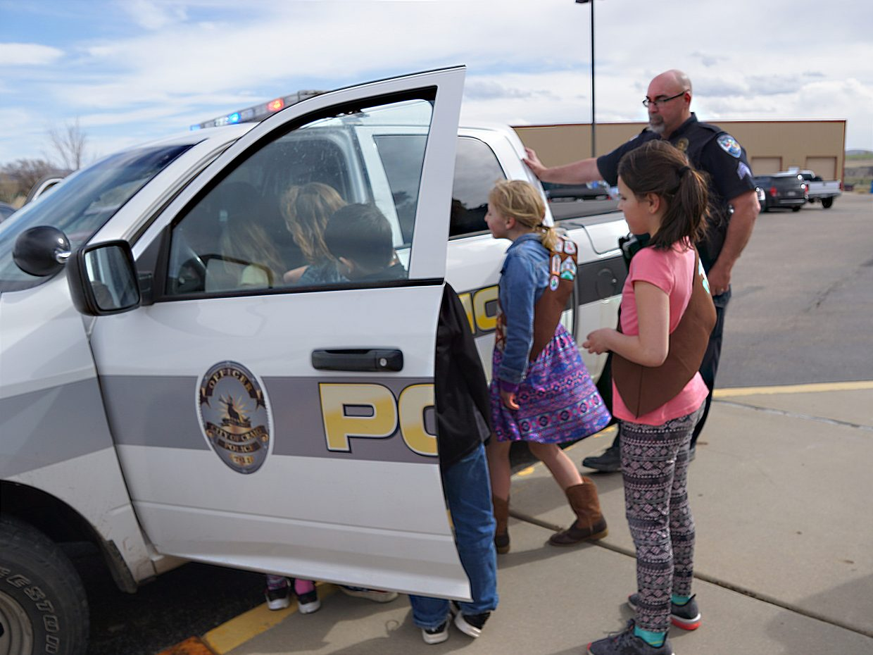 Haley Duran waits her turn to take a closer look at a patrol truck.