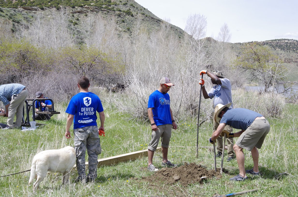Volunteers spent time digging holes and pounding posts.