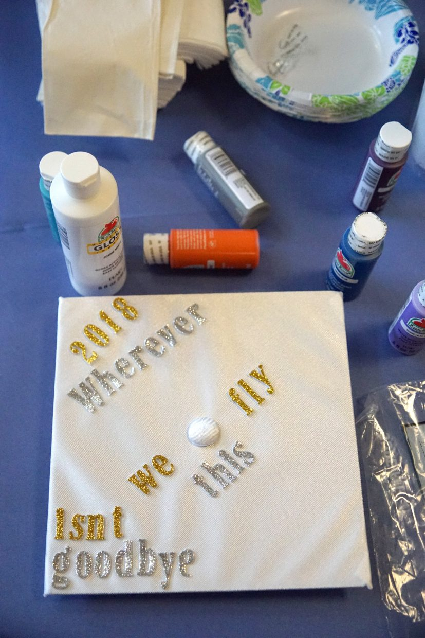 Paint, glitter, glue and decals were in demand by cap decorating seniors.
