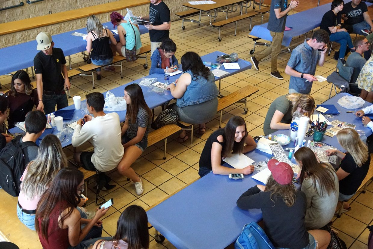 Moffat County High School Class of 2018 gathered in the cafeteria to decorate caps on the final day of class for seniors, May 18.