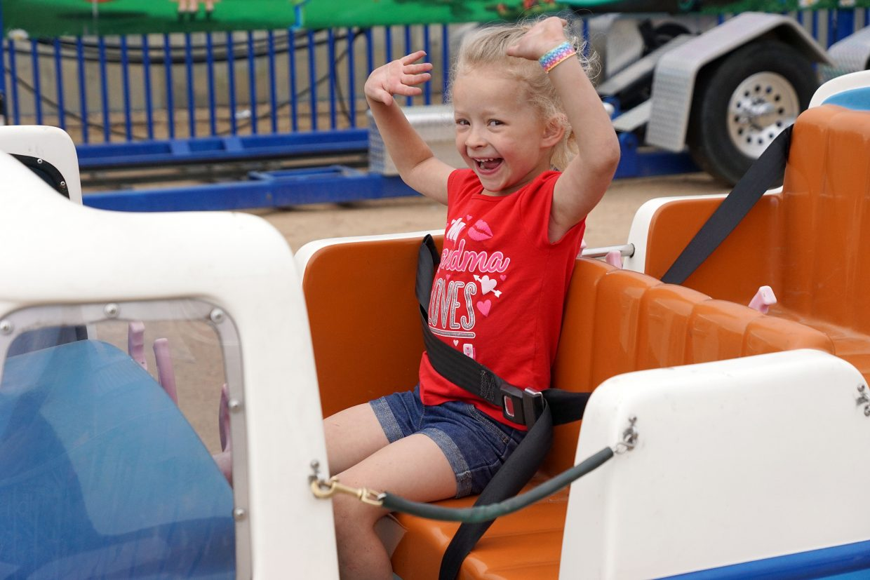 Arlea Pingley, 4, takes her hands off the wheel on the Groovy Bus ride.