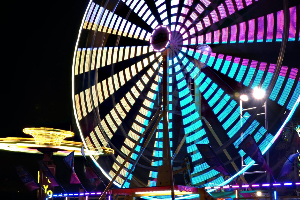 The ferris wheel lights up the night.