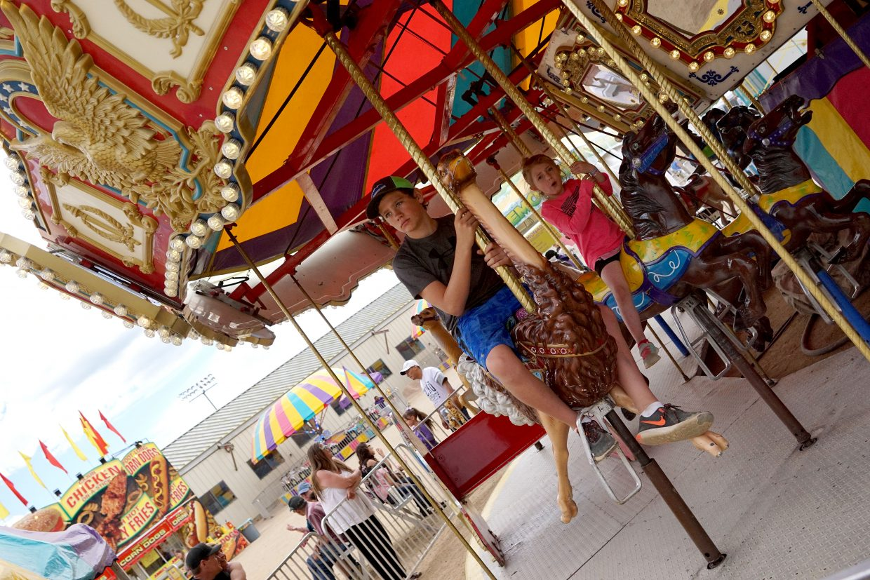 Children have fun on the merry-go-round.