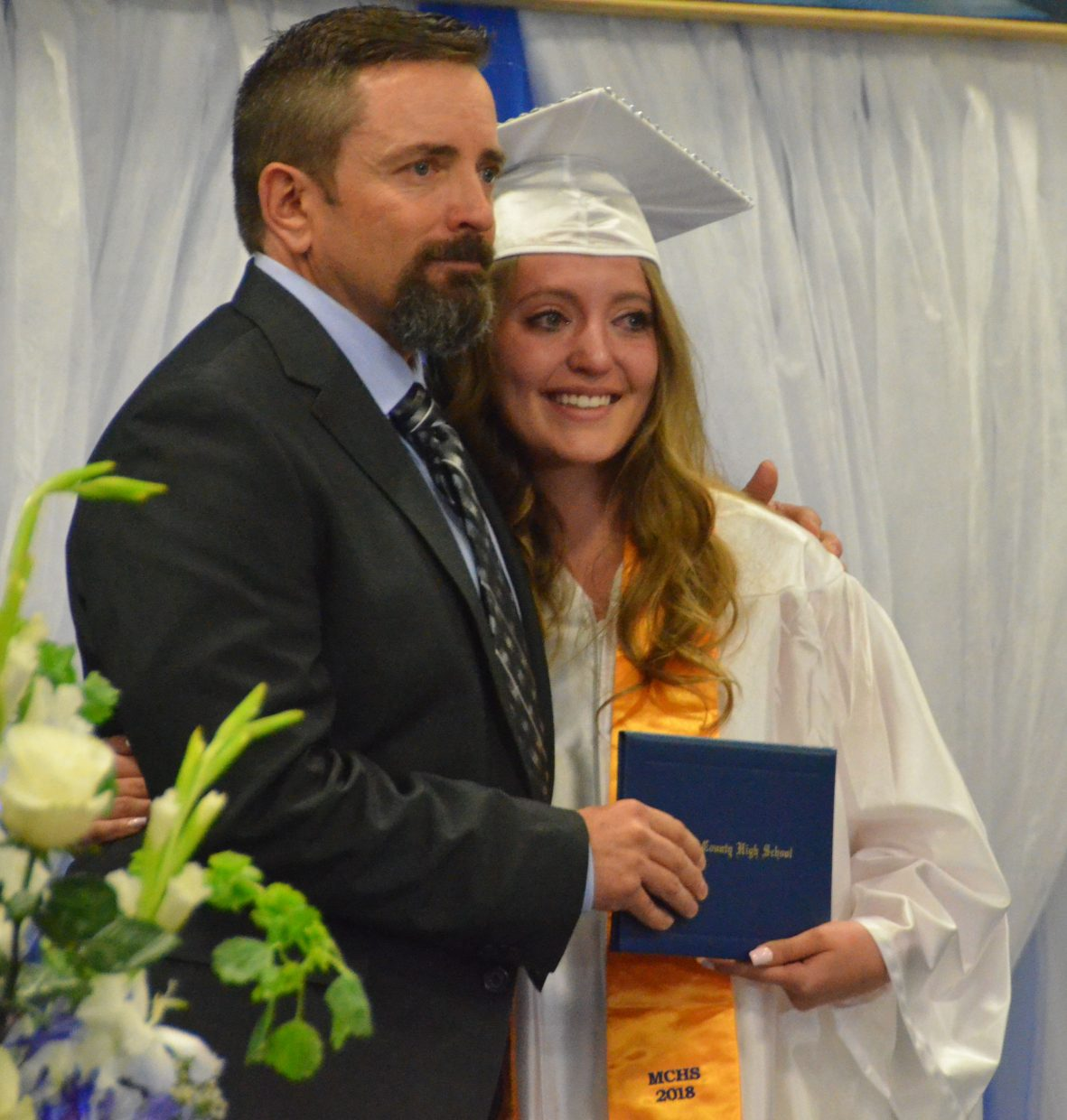 Moffat County High School's Kinleigh McIntyre gets emotional after receiving her diploma during Saturday's graduation ceremony.