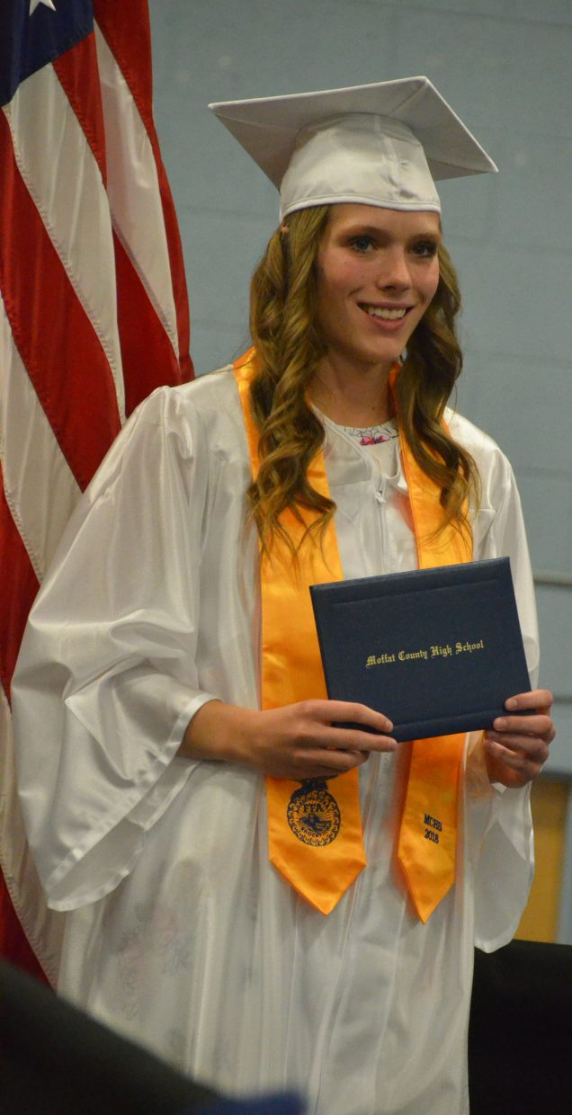Moffat County High School's Jaci McDiffett poses with her diploma during Saturday's graduation ceremony.