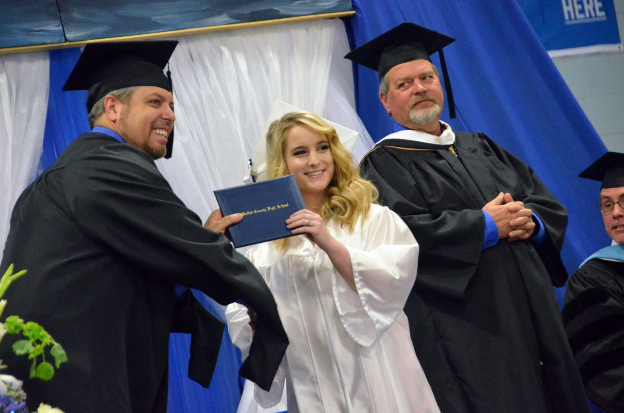 Moffat County High School's Madison Burch receives her diploma during Saturday's graduation ceremony.