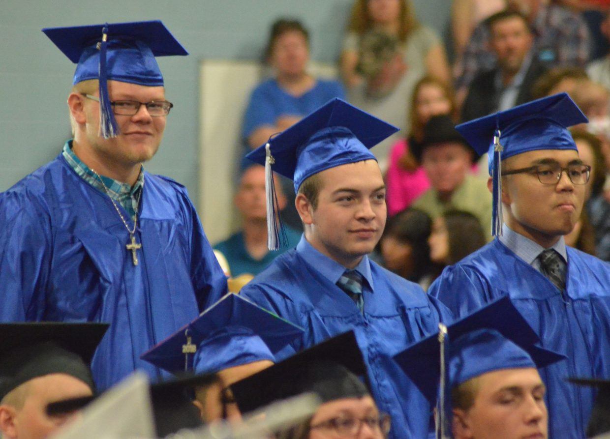 From left, Moffat County High School's Zane Shipman, Robert Schmidt and Leon Sanderson stand for acknowledgment as incoming military during Saturday's graduation ceremony.