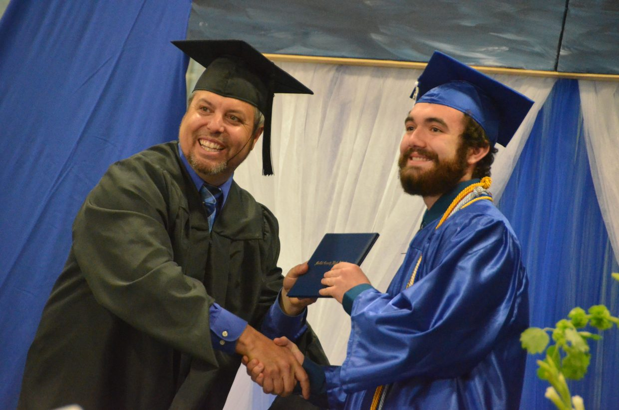 Moffat County High School's Isaac Trevenen receives his diploma during Saturday's graduation ceremony.