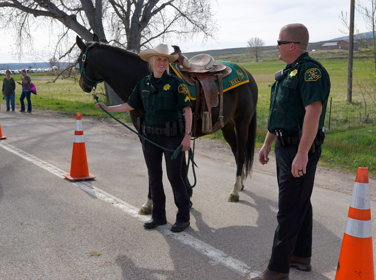 Mounted Patrol Officer Brittney Swartzell and her horse, Bull, stand beside Moffat County Sheriff KC Hume.