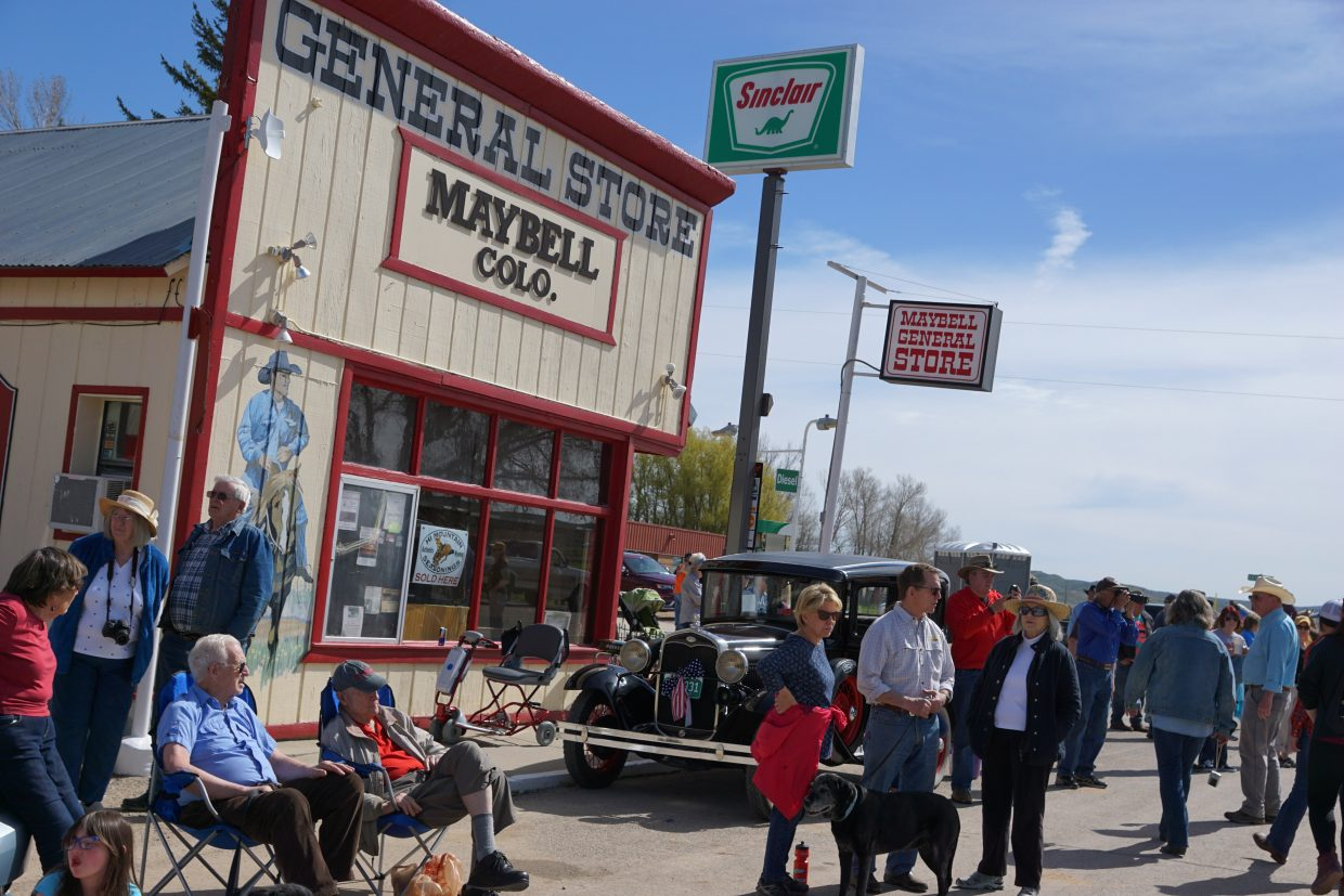 An old jalopy attracts attention as it sits outside the Maybell General Store.