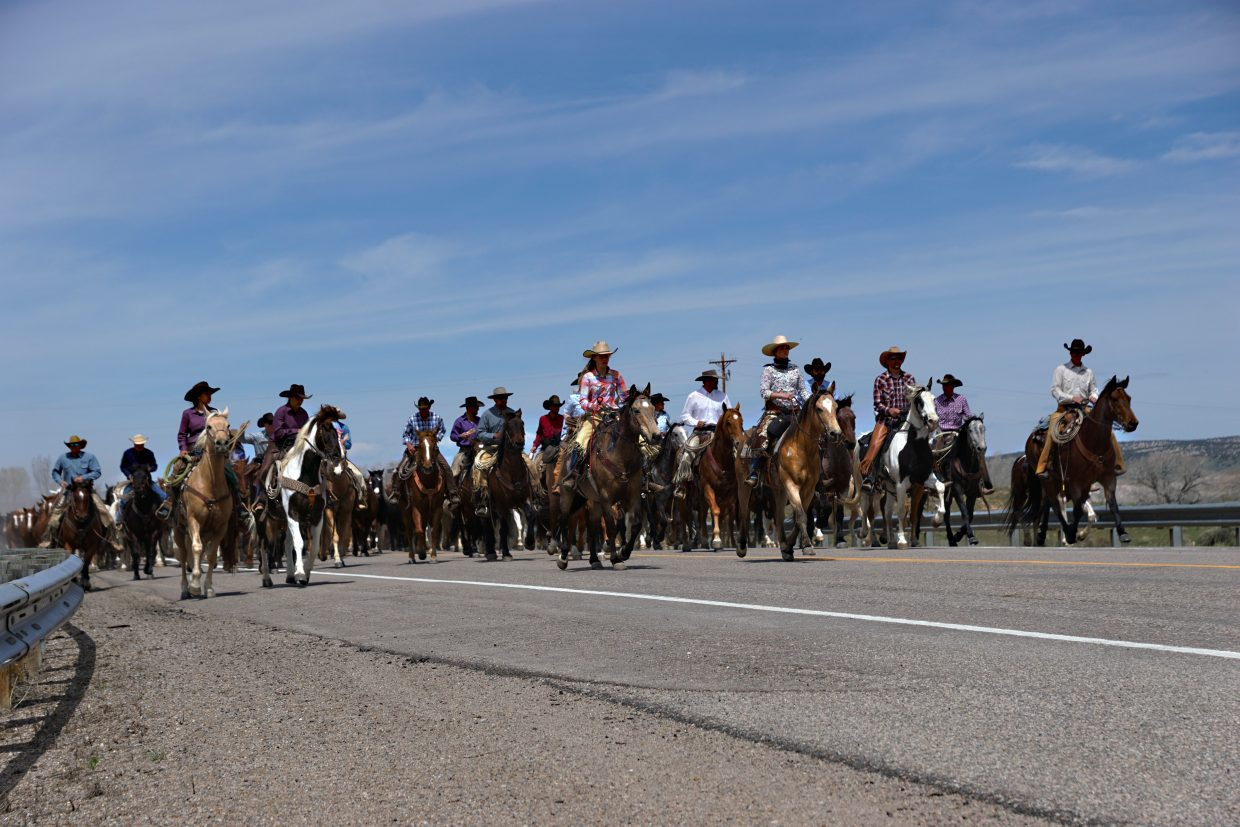Riders and horses fill U.S. Highway 40.