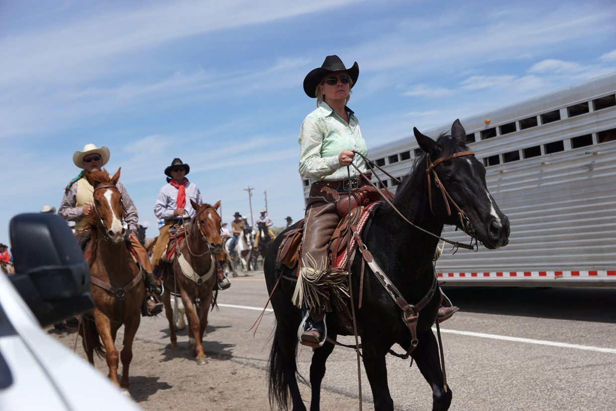 Riders weave through traffic during the 2018 Sombrero Ranches Great American Horse Drive.