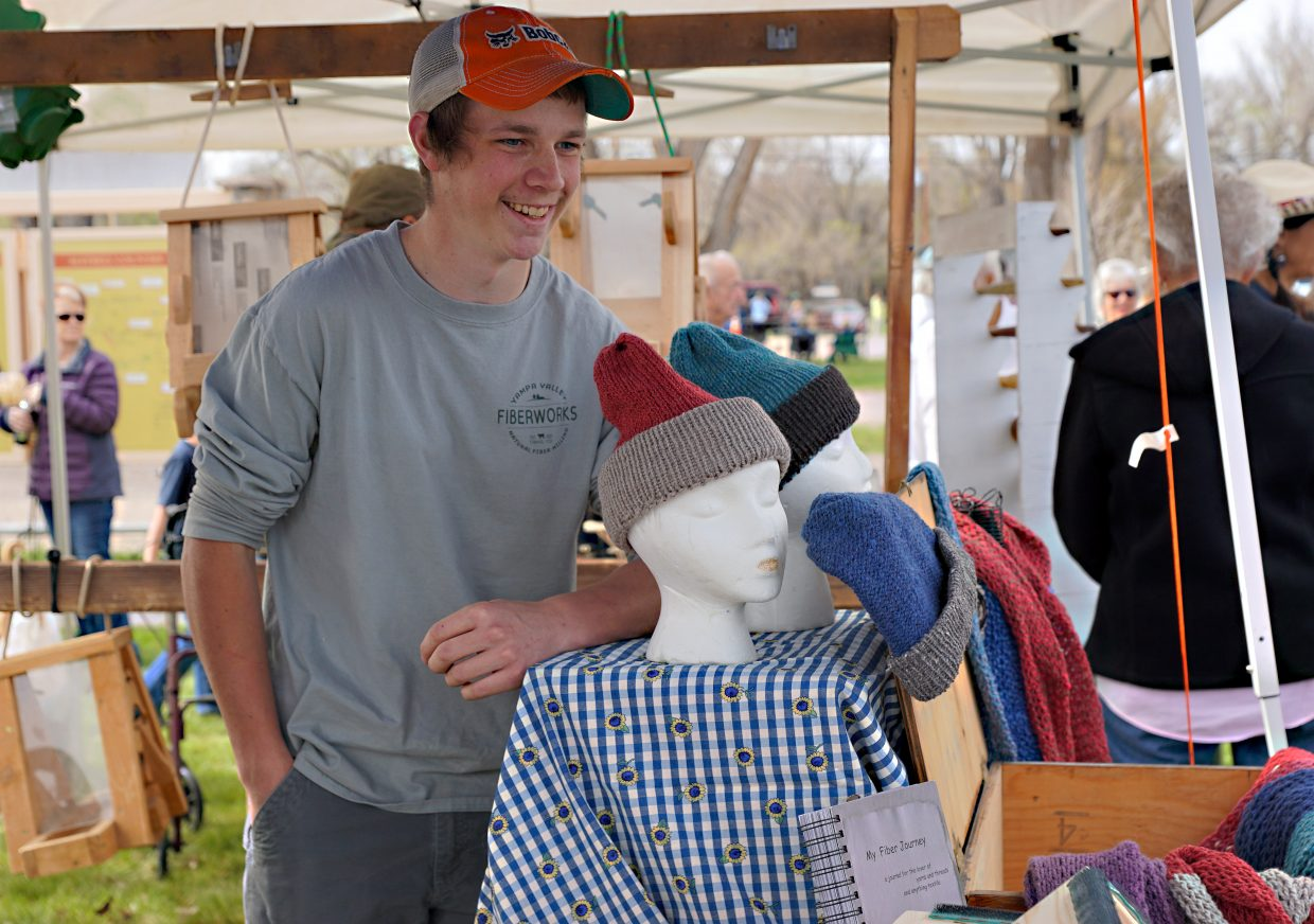 Hats and scarves made from local yarn by Tanner Snyder, pictured, were on offer at the Yampa Valley Fiberworks booth during Maybell Heritage Days, held in conjunction with the annual horse drive.
