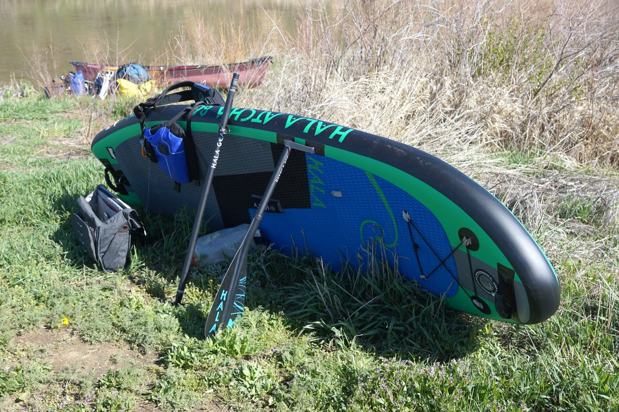 A paddle board is readied to luanch on a family friendly flat water stretch of the Yampa River between South Beach and Duffy Mountain river access points.