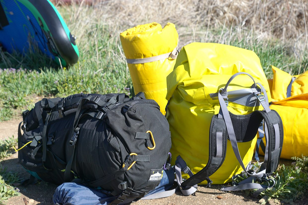 Bags of gear pile-up beside the South Beach river access.