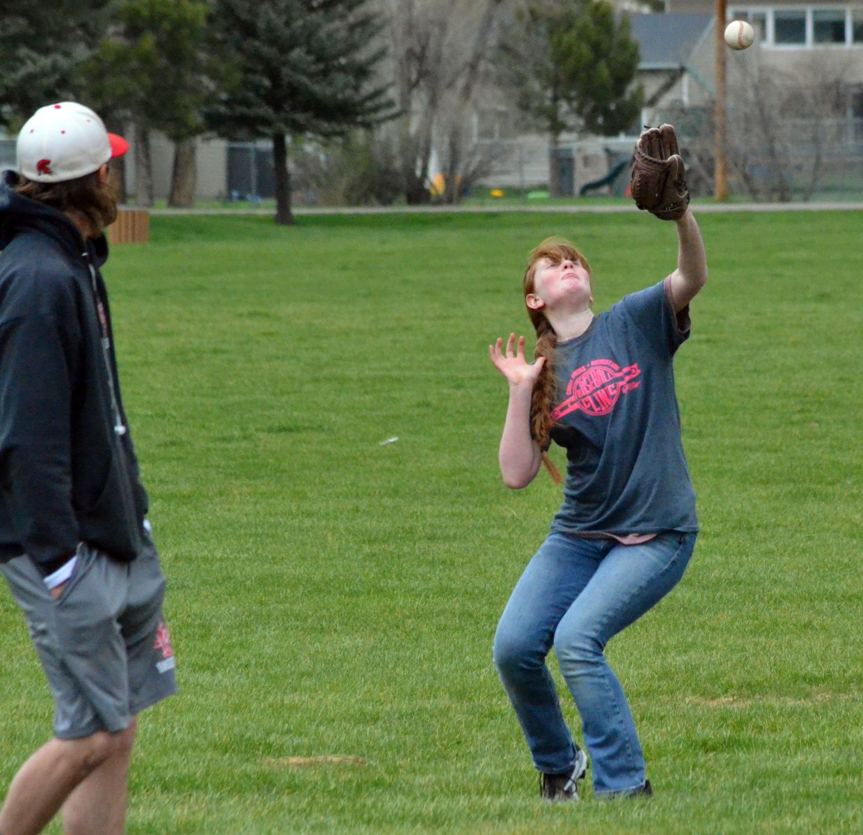 Dylan Herndon gets her mitt ready for a fly ball during the Spartan Baseball Clinic