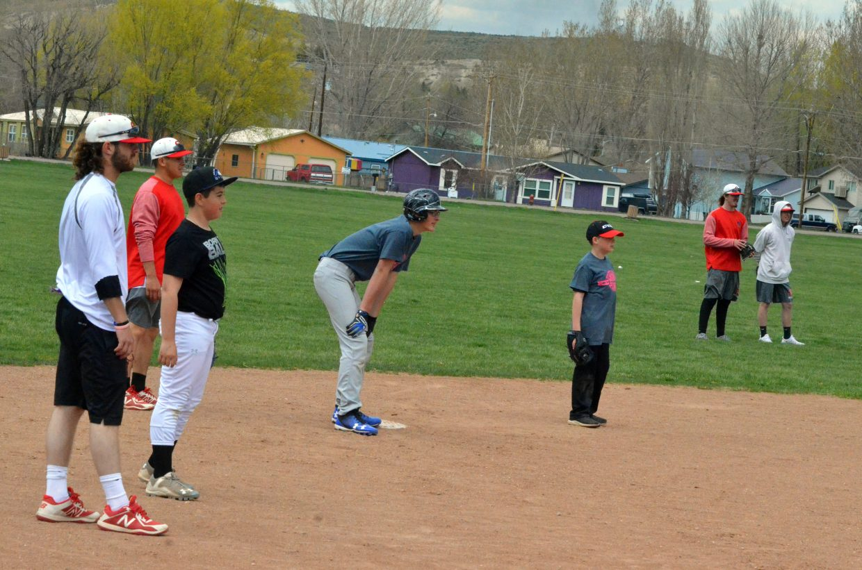 Colorado Northwestern Community College baseball players and younger athletes ready for another play during the Spartan Baseball Clinic