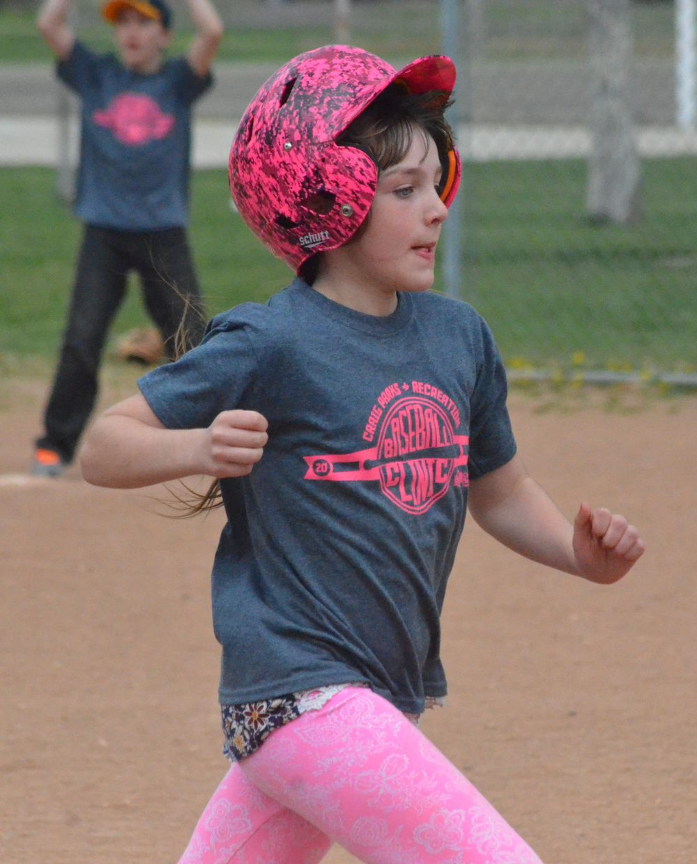 Joslyn Curtis hustles to third base during the Spartan Baseball Clinic