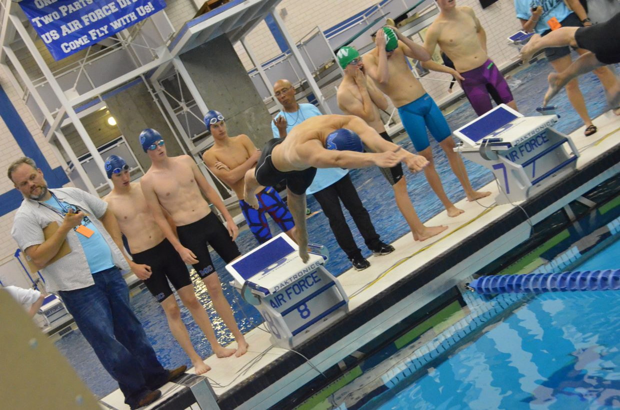 Moffat County High School's Jacob Briggs dives in to start the 400-yard freestyle relay as teammates David Prescott, Brandon Beason and Brooks Birkinbine stay ready Friday at the CHSAA State Championships at the US Air Force Academy.