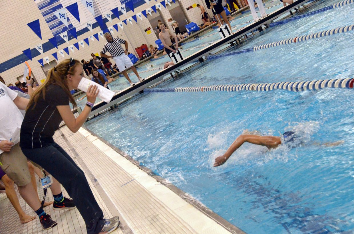 Moffat County High School swim coach Meghan Francone shouts encouragement to Brooks Birkinbine midway through the 500-yard freestyle race Friday at the CHSAA State Championships.