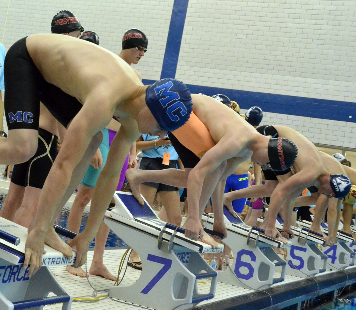 Moffat County High School's Devin McIntosh perches on the starting block to start the 200-yard freestyle relay Friday at the CHSAA State Championships.