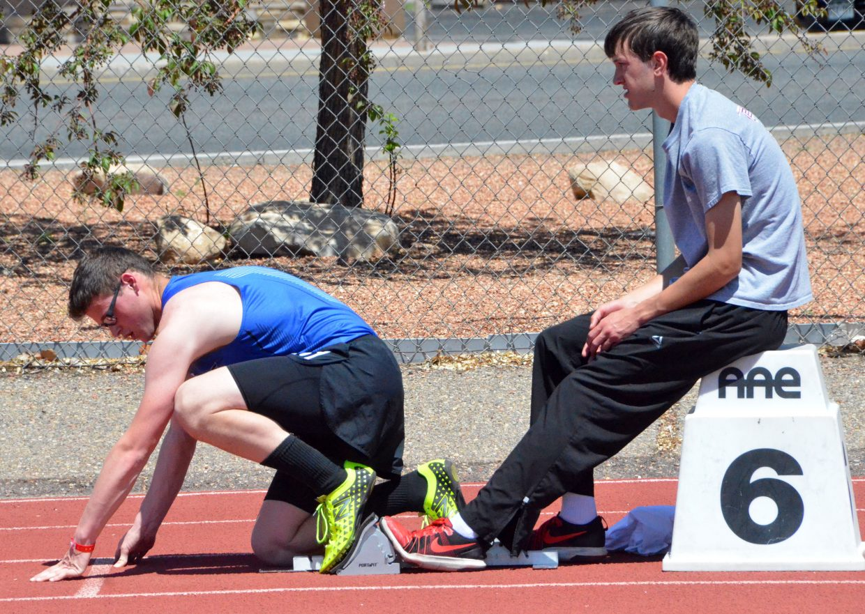 Moffat County High School's Colin Jensen gets set up on the starting blocks for the 400-meter dash preliminaries of Friday's Western Slope Multi-Leagues Meet.