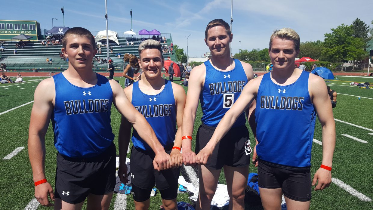 From left, Moffat County High School relay runners Elias Peroulis, Victor Silva, Miki Klimper and Jared Atkin grasp the baton together following their league title win in the 4x200 race.