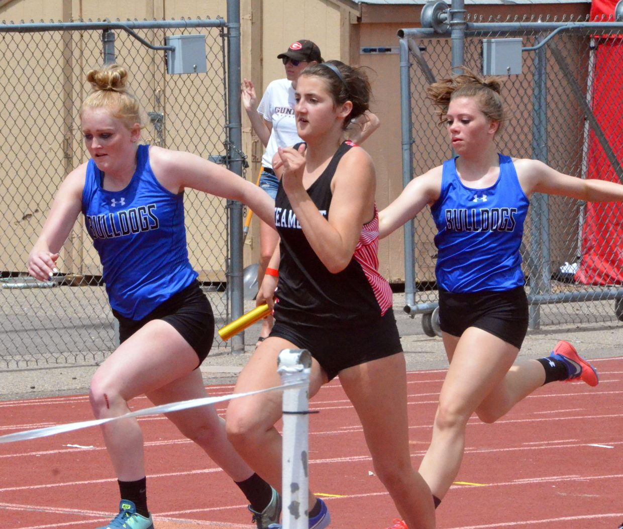 Moffat County High School's Jaidyn Steele, left, and Megan Olinger exchange the baton in the 4x100 relay at Saturday's Western Slope Multi-Leagues Meet.