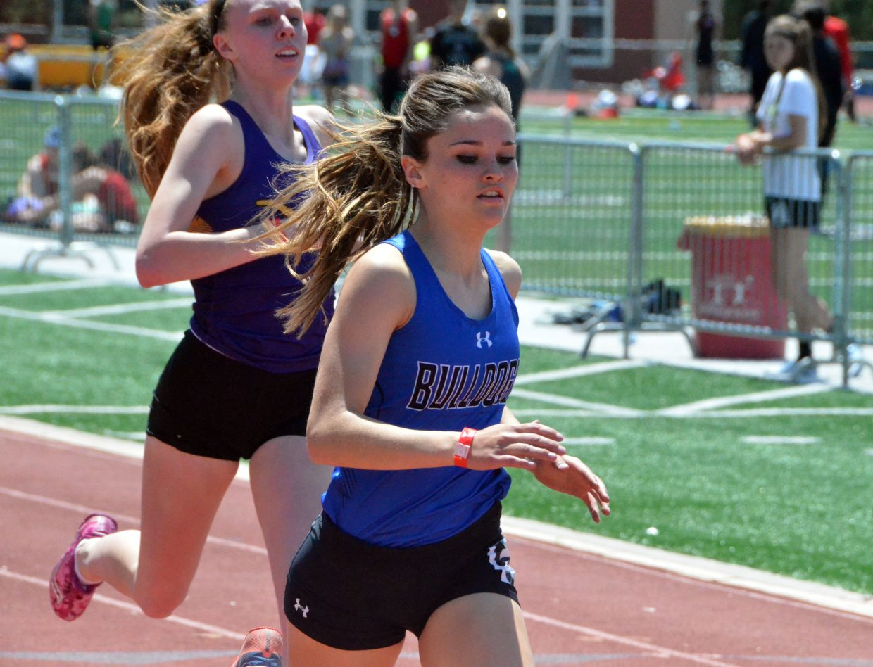 Moffat County High School's Stephenie Swindler overtakes Basalt's Megan Maley to beat her to the finish line in the 400-meter dash preliminaries of Friday's Western Slope Multi-Leagues Meet.