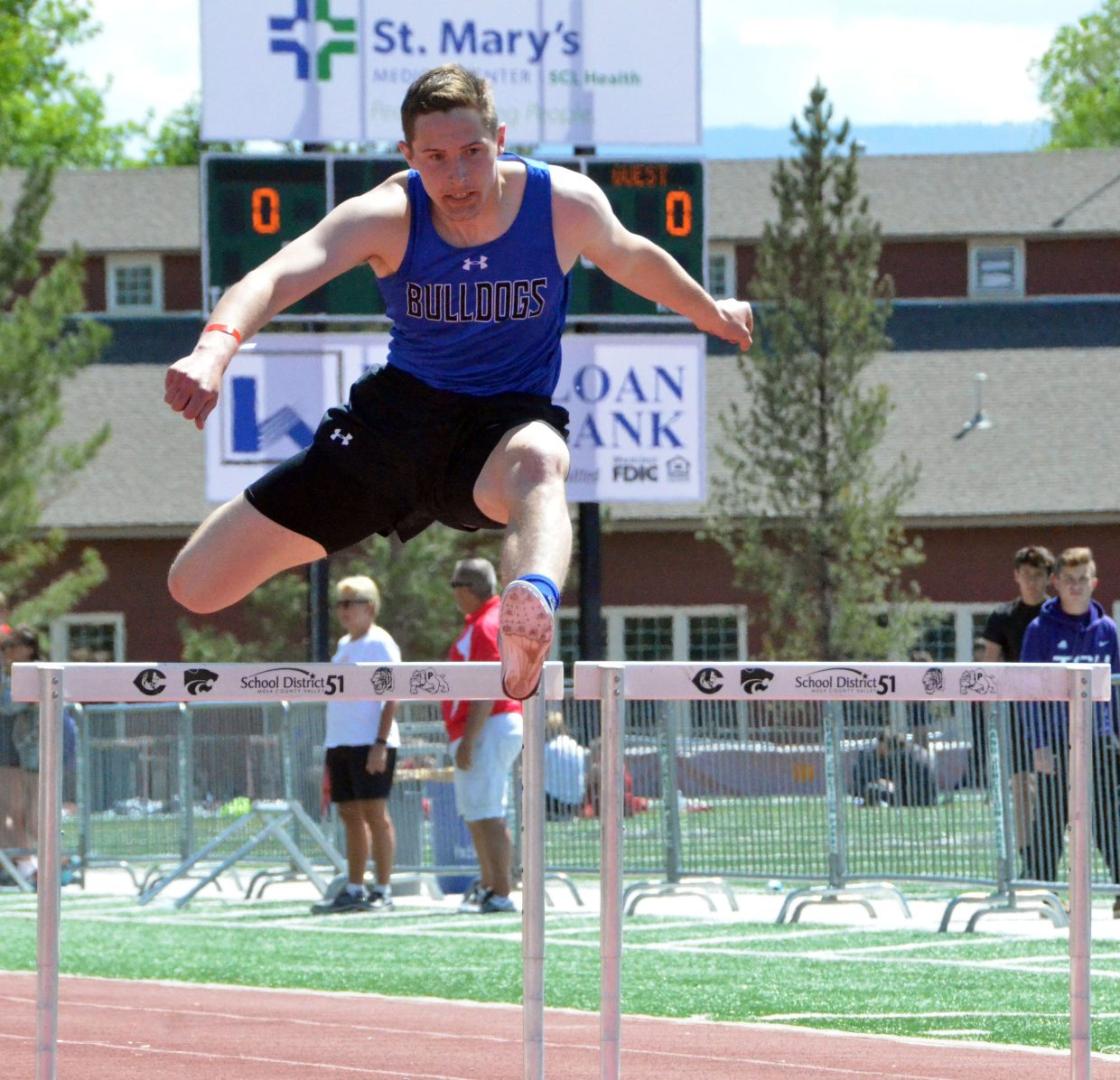 Moffat County High School's Miki Klimper vaults the final obstacle of the 300-meter hurdle preliminaries of Friday's Western Slope Multi-Leagues Meet.