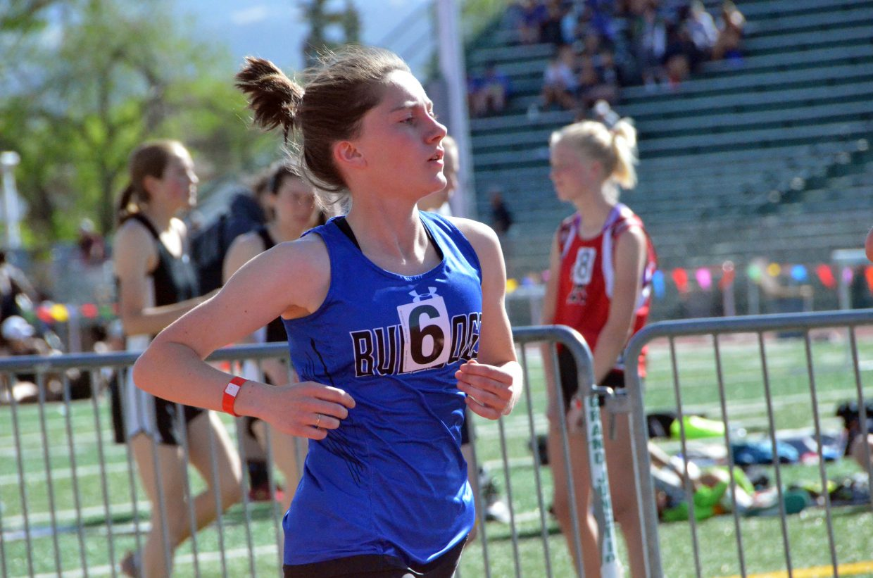 Moffat County High School's Allison Villard keeps the pace in the 800-meter run at Friday's Western Slope Multi-Leagues Meet.