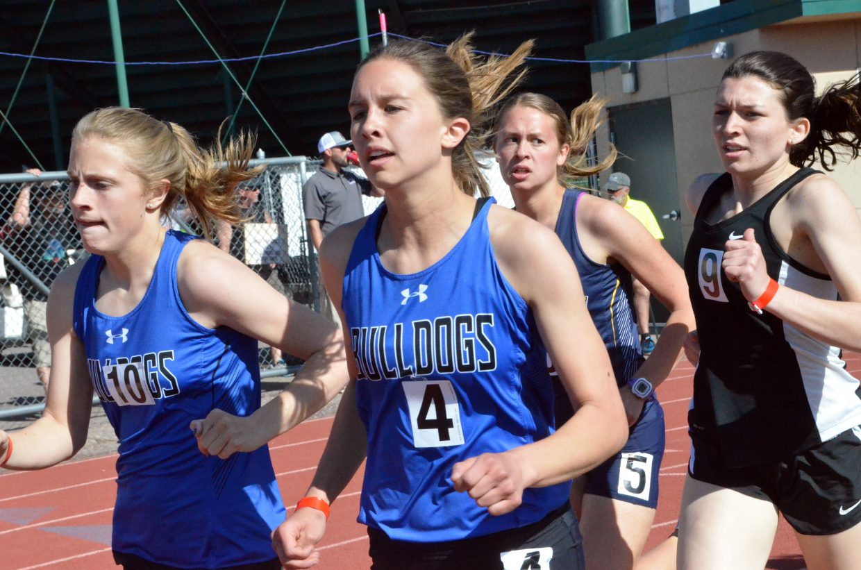 Moffat County High School's Kelsey McDiffett, left, and Emaleigh Paierski start the second lap of the 800-meter run in Friday's Western Slope Multi-Leagues Meet.