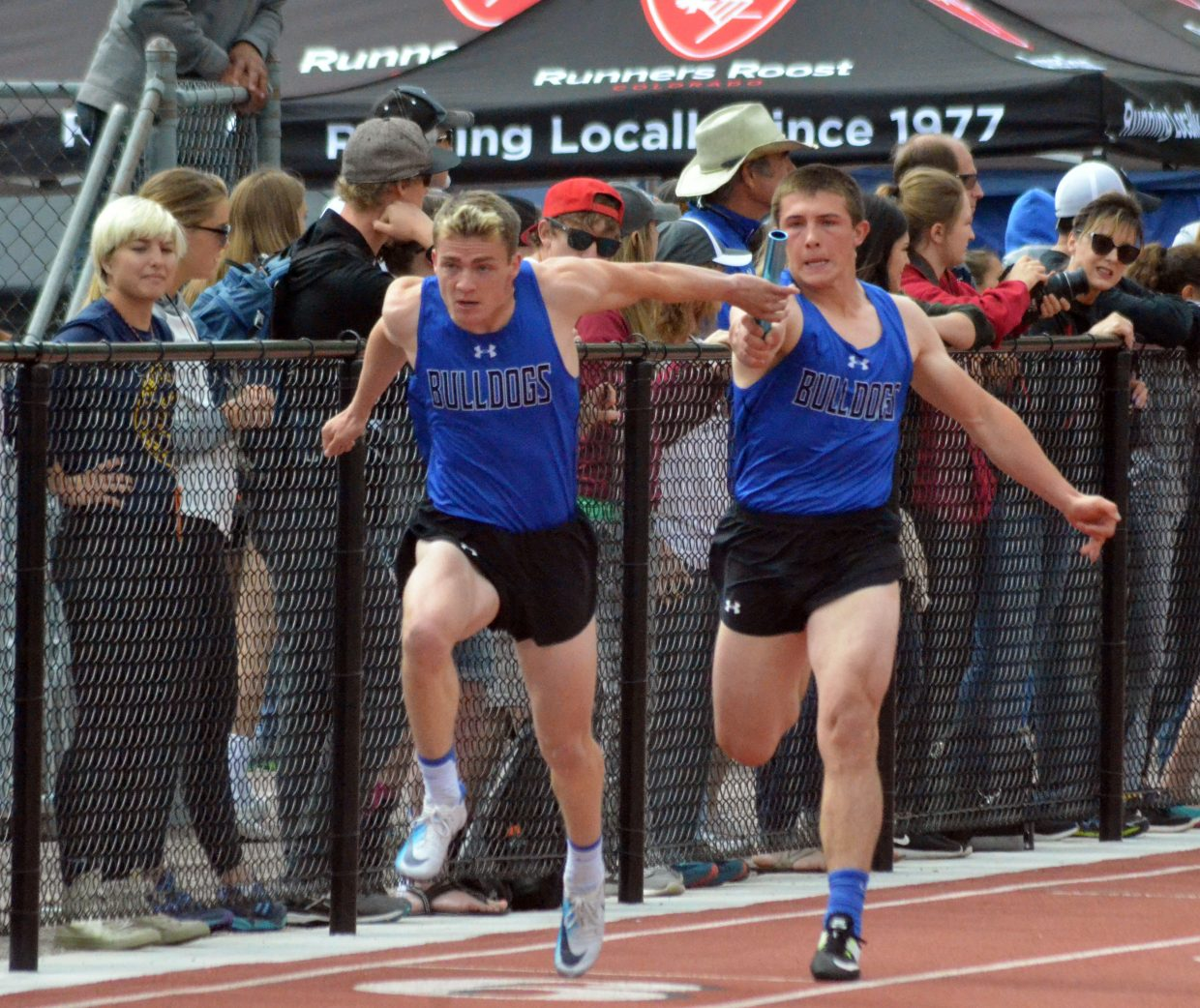 Moffat County High School's Jared Atkin, left, grabs the baton from Elias Peroulis to start the second leg of the 4x100-meter relay preliminaries Friday at the CHSAA State Championships.