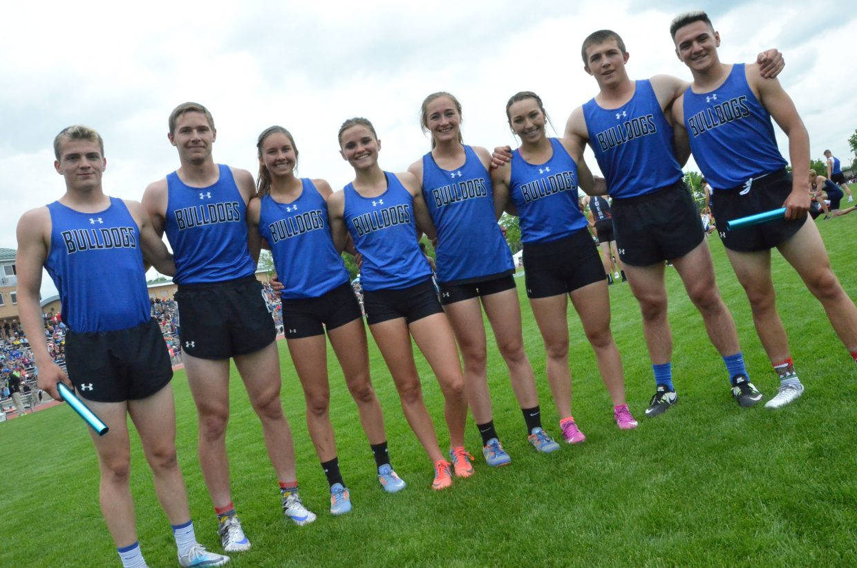 From left, Moffat County High School relay runners Jared Atkin, Miki Klimper, Emaleigh Papierski, Stephenie Swindler, Josie Timmer, Quinn Pinnt, Elias Peroulis and Victor Silva gather following the 4x200-meter relay finals Friday at the CHSAA State Championships.