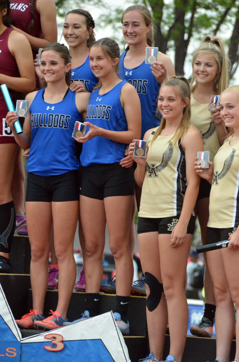 Clockwise from top left, Moffat County High School's Quinn Pinnt, Josie Timmer,  Emaleigh Papierski and Stephenie Swindler take the bronze in the 4x200-meter relay Friday at the CHSAA State Championships.