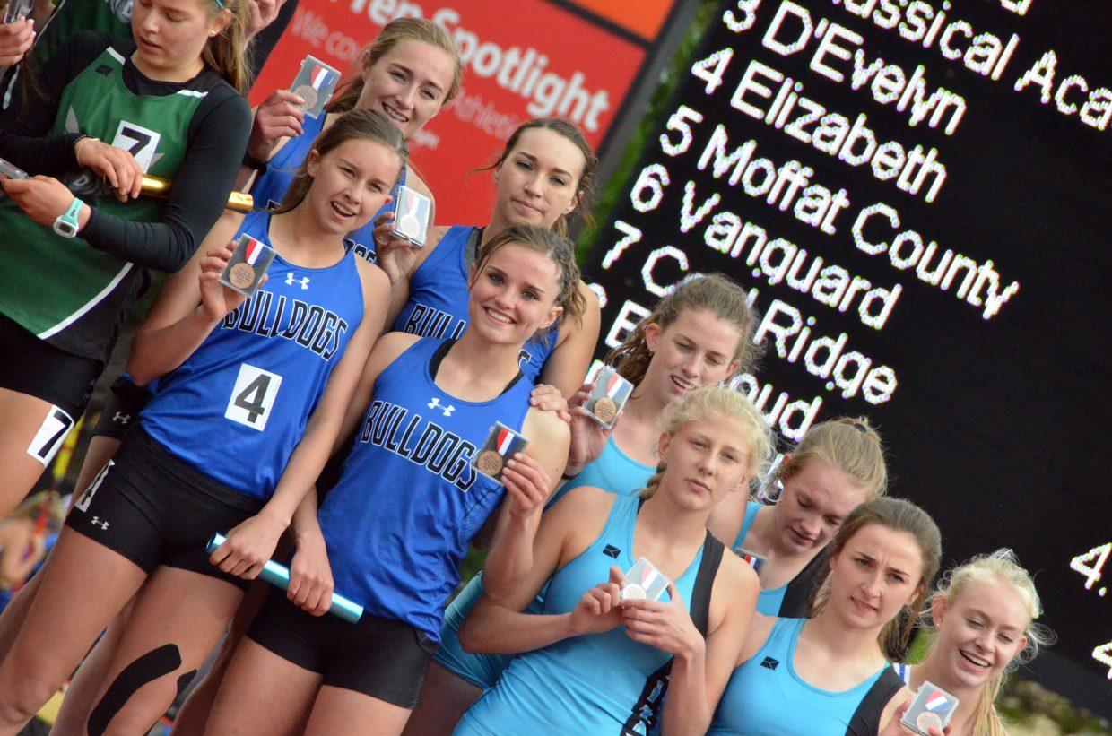 Clockwise from top left, Moffat County High School's Josie Timmer, Quinn Pinnt, Stephenie Swindler and Emaleigh Papierski display fifth-place medals for the 4x400-meter relay Saturday at the CHSAA State Championships.