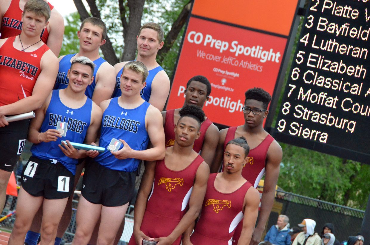 Clockwise from top left, Moffat County High School's Elias Peroulis, Miki Klimper, Jared Atkin and Victor Silva display seventh-place medals for the 4x100-meter relay Saturday at the CHSAA State Championships.
