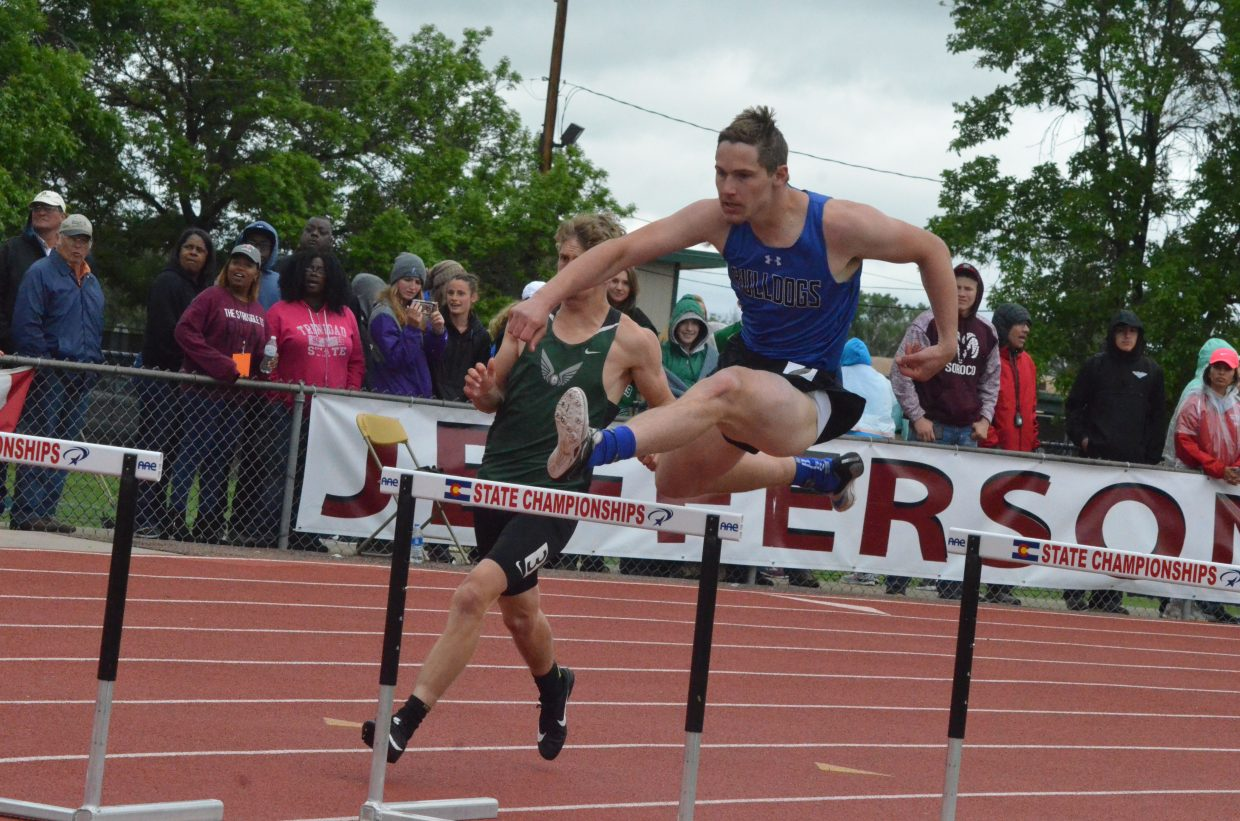 Moffat County High School's Miki Klimper heads into the final turn of the 300-meter hurdles Saturday at the CHSAA State Championships.